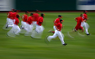 The Los Angeles Angels of Anaheim run sprints during a Spring Training workout at Tempe Diablo Stadium Tuesday February 28, 2006.