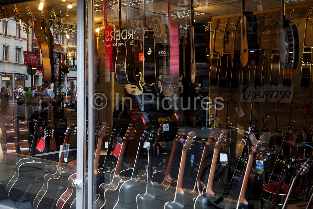 Music shops on Denmark Street, London. Also known as Tin Pan Alley, this is the most well known place for musical instruments in the city.