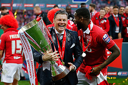 A Champagne drenched Bristol City Manager Steve Cotterill jokes with Jay Emmanuel-Thomas as he lifts the Football League Trophy after thay win the match 2-0 - Photo mandatory by-line: Rogan Thomson/JMP - 07966 386802 - 22/03/2015 - SPORT - FOOTBALL - London, England - Wembley Stadium - Bristol City v Walsall - Johnstone's Paint Trophy Final.