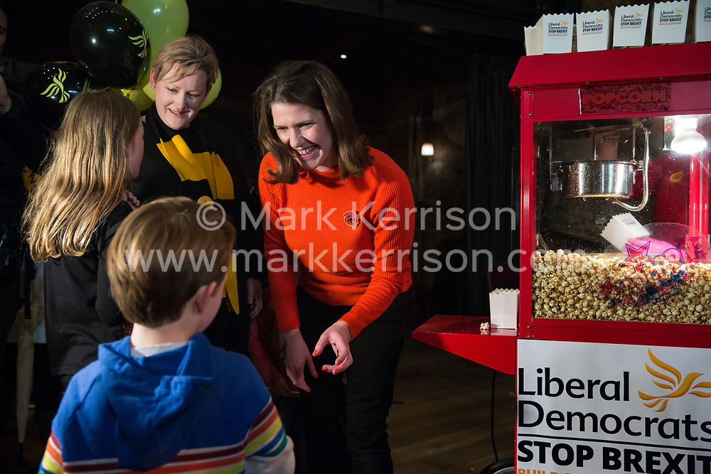 London, UK. 9 November, 2019. Jo Swinson, leader of the Liberal Democrats, hands popcorn to a child at the Rally for the Future in Battersea in order to set out the party's vision to Stop Brexit and Build A Brighter Future.