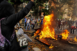 Group of opposition supporters set fire to the Bolivarian National Guard motorcycle during a protest against Venezuelan President Nicolás Maduro in Caracas on May 3, 2017