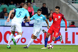 Dele Alli of England takes on Bosrjan Cesar and Bojan Jokic of Slovenia - Mandatory by-line: Robbie Stephenson/JMP - 11/10/2016 - FOOTBALL - RSC Stozice - Ljubljana, England - Slovenia v England - World Cup European Qualifier