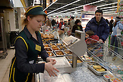 Moscow, Russia, 03/01/2004..Customers in the ready cooked meals section at the Mosmart shopping mall.
