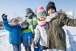 Portrait of children in winter clothes