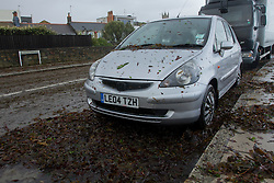 © Licensed to London News Pictures. 15/08/2012. Penzance, UK.  A car covered in and surrounded by seaweed deposited on it by strong winds and large waves on Penzance Promenade. Photo credit : Ashley Hugo/LNP