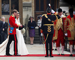29 April 2011. London, England..Royal wedding day. Princess Kate (Catherine) Middleton and her new husband, Prince William depart Westminster Abbey..Photo; Charlie Varley.