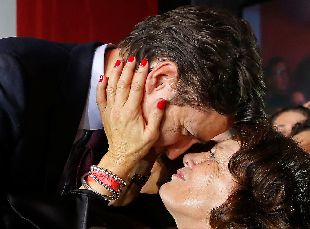 Liberal leader Justin Trudeau is embraced by his mother Margaret Trudeau (R) as he arrives to give his victory speech after Canada's federal election in Montreal, Quebec, October 19, 2015.   REUTERS/Jim Young