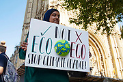 A muslim teenage girl protests at the Global Climate Strike on 20th September, 2019 in London, United Kingdom. Inspired by teenage climate activist Greta Thurnburg, millions of workers and students around the world are striking  to take part in climate strike protests to demand governments take action.