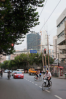 street scene with bikes and cars in Shanghai China