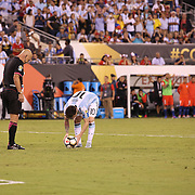 EAST RUTHERFORD, NEW JERSEY - JUNE 26: Lionel Messi #10 of Argentina puts the ball on the penalty spot watched by  Brazilian referee Heber Lopes in the penalty shoot out during the Argentina Vs Chile Final match of the Copa America Centenario USA 2016 Tournament at MetLife Stadium on June 26, 2016 in East Rutherford, New Jersey. (Photo by Tim Clayton/Corbis via Getty Images)