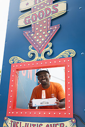 July 3, 2017 - Seattle, Washington, United States - Seattle, Washington: An employee offers a package at Amazon.com's Treasure Truck at the South Lake Union Discovery Center. The service is tied in with Amazon's mobile shopping app offering a flash sale on a specific product. The kitschy truck, described as an ice cream truck for adults, allows customers to pick up their purchases at a variety of predetermined drop-off points. The service is only being offered in Amazon.com's hometown of Seattle. Taking advantage of the upcoming Fourth of July holiday, the current deal offered is a box of grillable meats. (Credit Image: © Paul Gordon via ZUMA Wire)