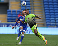 Liam Moore of Reading gets to the ball ahead of Anthony Pilkington of Cardiff city (l). EFL Skybet championship match, Cardiff city v Reading at the Cardiff city stadium in Cardiff, South Wales on Saturday 27th August 2016.<br /> pic by Andrew Orchard, Andrew Orchard sports photography.