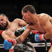 KISSIMMEE, FL - MARCH 05:   Yomar Alamo gets punched by Jesus Alberto Beltran during the Boxeo Telemundo All Star Boxing event at Osceola Heritage Park on March 5, 2021 in Kissimmee, Florida. (Photo by Alex Menendez/Getty Images) *** Local Caption *** Yomar Alamo; Jesus Alberto Beltran