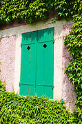 Shuttered window at Claude Monet house and gardens, Giverny, France