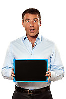 one surprised caucasian business man holding a blackboard copy space message in studio isolated on white background