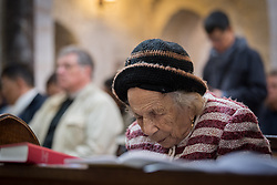 20 April 2019, Jerusalem: An old woman congregant prays during Easter Sunday service at the Cathedral Church of Saint George the Martyr, Jerusalem.