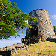 Windmill at the Annaberg Sugar Plantation Ruins on the north shore of St. John in the US Virgin Islands. An eighteenth century plantation that produced sugar, molasses, and rum, the planation consisted of about 518 acres of steep land, with the main buildings perched on a small headland near Maho Bay and overlooking Mary Point.