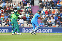 Cricket - 2019 ICC Cricket World Cup - Group Stage: South Africa vs. India<br /> <br /> Rohit Sharma of India cuts the ball away to the boundary for four during the cricket world cup match at the Hampshire Bowl Southampton England<br /> <br /> COLORSPORT/SHAUN BOGGUST