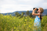 Girl with Binoculars bird watching in Montana.