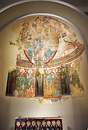 Apse of Saint Peter de la Seu d'Urgell<br /> <br /> Second quarter of the twelfth century<br /> Fresco transferred to canvas<br /> From the church of St. Peter currently dedicated to St. Michael and St. Peter Cathedral group of Seu d'Urgell (Alt Urgell)<br /> <br /> Acquisition of the Museum Board Campaign 1919-1923<br /> MNAC 15867<br /> <br /> <br /> The apse is the most important part of the church as it was where the altar was located. The apse of La Seu d'Urgell like most Romanesque apses was decorated with frescoes of a Theophany (referring to images of the Incarnation of Jesus).High up in the semi circular cupola of the apse is a large image of Christ in Majesty, or Christ Pantocrator, in a mandorla, a pointed verticle oval shaped aureola which surrounds the figures of Christ and the Virgin Mary in traditional Christian art.  This is flanked by Tetramorph showing the four evangelical symbols - St Matthew the man, St Mark the lion, St Luke the ox, and John the eagle. In the middle register is are a series of  frescoes of the Apostles and the figure of Mary. The lower register, which has not been preserved, must have been painted curtains that imitated luxury fabrics. .<br /> <br /> If you prefer you can also buy from our ALAMY PHOTO LIBRARY  Collection visit : https://www.alamy.com/portfolio/paul-williams-funkystock/romanesque-art-antiquities.html<br /> Type -     MNAC     - into the LOWER SEARCH WITHIN GALLERY box. Refine search by adding background colour, place, subject etc<br /> <br /> Visit our ROMANESQUE SCULPTURE PHOTO COLLECTION for more   photos  to download or buy as prints https://funkystock.photoshelter.com/gallery/Romanesque-Statue-Sculptures-Pictures-Images/G0000ezFHYeF_xRI/C0000YpKXiAHnG2k
