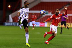 Michael Ihiekwe of Rotherham United hoofs the ball away from Lewis Grabban of Nottingham Forest - Mandatory by-line: Ryan Crockett/JMP - 20/10/2020 - FOOTBALL - The City Ground - Nottingham, England - Nottingham Forest v Rotherham United - Sky Bet Championship