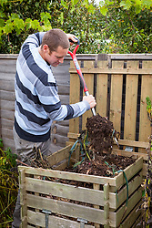 Turning over a compost heap with a fork