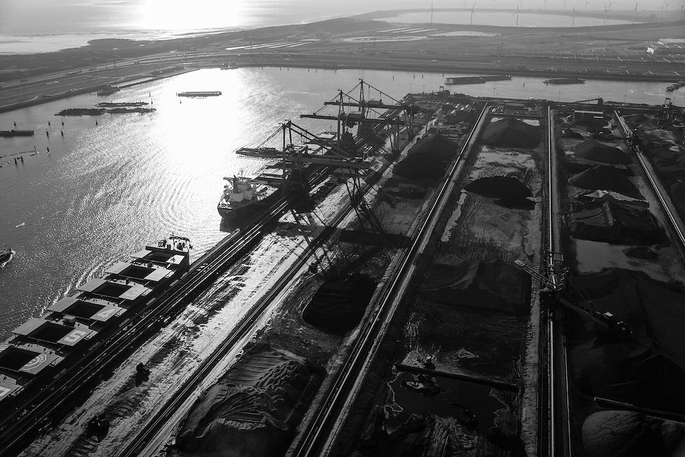 Nederland, Zuid-Holland, Rotterdam, 18-02-2015; Eerste Maasvlakte met aan de Mississippihaven Europees Massagoed Overslagbedrijf (EMO). Gespecialiseerd in de overslag van kolen en ijzererts. In de achtergrond Tweede Maasvlakte (MV2) en De Slufter.<br /> EMO transhipment terminal for coal and iron ore and other dry bulk.<br /> luchtfoto (toeslag op standard tarieven);<br /> aerial photo (additional fee required);<br /> copyright foto/photo Siebe Swart