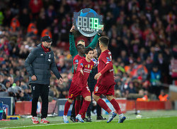 LIVERPOOL, ENGLAND - Wednesday, March 11, 2020: Liverpool's substitute Takumi Minamino comes on for Roberto Firmino during the UEFA Champions League Round of 16 2nd Leg match between Liverpool FC and Club Atlético de Madrid at Anfield. (Pic by David Rawcliffe/Propaganda)
