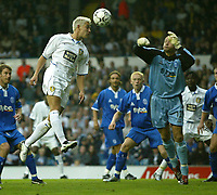 Photo. Andrew Unwin<br /> Leeds United v Birmingham City, Barclaycard Premier league, Elland Road, Leeds 20/09/2003.<br /> Leeds' Alan Smith (l) tries to beat Birmingham's Maik Taylor (r) in the air.