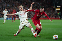 Football - 2021 / 2022 UEFA Champions League - Group B, Round One - Liverpool vs AC Milan - Anfield - Wednesday 15th September 2021<br /> <br /> <br /> AC Milans Alexis Saelemaekers battles with Liverpool's Andy Robertson<br /> <br /> <br /> <br /> Credit COLORSPORT/Terry Donnelly