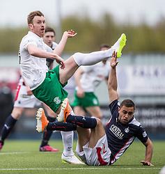Hibernian's Liam Craig and Falkirk's Tom Taiwo. <br /> Falkirk 0 v 3 Hibernian, Scottish Championship game played at The Falkirk Stadium 2/5/2015.