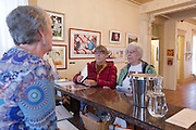 Customers Sue Heise (C) and Klaras Ihnken (R) speak with proprietor Susan Williams Deborah at Gallery 360 which has opened  in its new space at the Slocum House in downtown Vancouver Saturday November 1, 2014.. (Natalie Behring/for the Columbian)