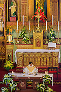 08 APRIL 2012 - HANOI, VIETNAM:     Easter Sunday mass in St. Joseph Cathedral in Hanoi, Vietnam. St. Joseph Cathedral in Hanoi is the seat of the Roman Catholic Archdiocese of Hanoi and is one of the most important Catholic churches in Vietnam. It was built in 1886 and is especially crowded on religious holidays, like Easter. The church holds three Easter masses on Easter Sunday morning. There are more than 5.6 million Roman Catholics in Vietnam, nearly 7% of the population. Catholicism came to what is now Vietnam with Portuguese missionaries in the 16th Century, but it wasn't until the arrival of French missionaries and later colonial authorities that Catholicism became a part of Vietnamese religious life.   PHOTO BY JACK KURTZ