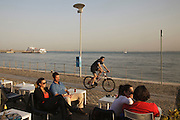 """Meninos do Rio"" bar and esplanade by Tagus riverside in Lisbon."