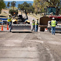 051313       Brian Leddy<br /> Construction crews resurface Window Rock Boulevard Monday afternoon. The road, which leads to the Navajo Nation council chambers, presidents office and other government offices was heavily potholed and due for repair.