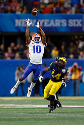 Florida Gators wide receiver Josh Hammond #10 catches a pass during the Chick-fil-A Peach Bowl, Saturday, December 29, 2018, in Atlanta. ( Paul Abell via Abell Images for Chick-fil-A Peach Bowl)