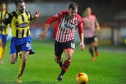 Dagenham & Redbridge's James Dunne and Exeter City's Lee Holmes during the Sky Bet League 2 match between Exeter City and Dagenham and Redbridge at St James' Park, Exeter, England on 2 January 2016. Photo by Graham Hunt.