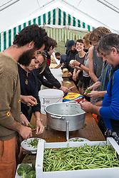Roydon, Essex, UK. 27 July, 2019. Volunteers prepare food at Reclaim The Power's Power Beyond Borders mass action camp.