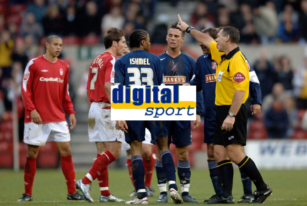 Photo: Glyn Thomas.<br />Nottingham Forest v Walsall. Coca Cola League 1.<br />10/12/2005.<br />Walsall's Ishmel Demontagnac (C) is ordered off the pitch by referee C Penton (R) after being shown the red card for punching Nicky Southall in the face.