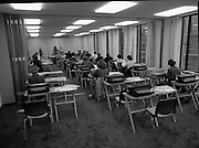 Conference Room at the EEC Building.   (N60)..1981..07.02.1981..02.07.1981..7th February 1981...At the EEC offices, 39 Molesworth Street, the conference room was converted to an examination hall for the purpose of recruiting staff..Image shows the room laid out with secretarial equipment as the applicants take their places for the exam.