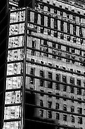 New York reflection on a building on 57 street. mirror game
