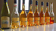 The Disznoko winery in Tokaj: in the tasting room, bottles of Tokaj: Szamorodni Edes (sweet) 2000, Aszu 4 puttonyos 1998, 5 puttonyos 1995... and at the end Ezsencia 2000 (which is still unclear). There is a remarkable difference in colour. Generally the deeper the older. And the eszencia is even darker and not quite clear. The aszus are really much more of a wine experience. The Disznók? winery is owned by AXA Millesimes, a French insurance company. Disznoko means pig's head since a big rock in the vineyard supposedly looks like that. The new winery is impressive and a vast amount of money has been invested. Credit Per Karlsson BKWine.com