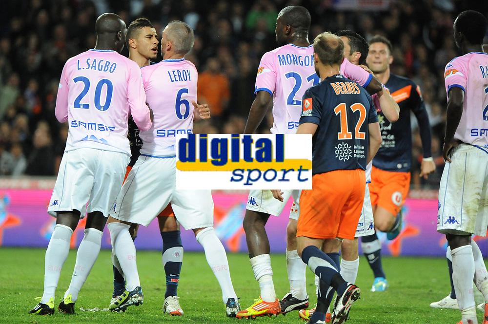 FOOTBALL - FRENCH CHAMPIONSHIP 2011/2012 - L1 - MONTPELLIER HSC v EVIAN TG - 1/05/2012 - PHOTO SYLVAIN THOMAS / DPPI - YOUNES BELHANDA (MHSC) / JEROME LEROY (EVIAN)