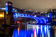 The Fremont Bridge glows during a preview of the Bridge Lights project  The light display, installed under the bridge and on the bridge sidewalks, will be permanently lit. (Courtney Pedroza / The Seattle Times, 2018)