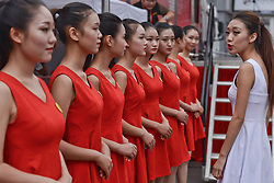 September 13, 2016 - Pingchang, China - Hostesses prepare for the opening ceremony of the fourth stage, 157.57 km from Bazhong to Pingchang, during the 2016 Tour of China 1...On Tuesday, 13 September 2016, in Pingchang, China. (Credit Image: © Artur Widak/NurPhoto via ZUMA Press)