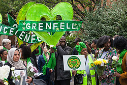 London, UK. 14 June, 2019. Family members prepare to walk in silence to lay tributes at the foot of the Grenfell Tower following a memorial service at St Helen's Church to mark the second anniversary of the Grenfell Tower fire on 14th June 2017 in which 72 people died and over 70 were injured.