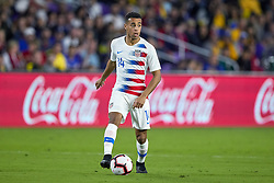 March 21, 2019 - Orlando, FL, U.S. - ORLANDO, FL - MARCH 21: United States midfielder Tyler Adams (14) dribbles the ball in game action during an International friendly match between the United States and Ecuador on March 21, 2019 at Orlando City Stadium in Orlando, FL. (Photo by Robin Alam/Icon Sportswire) (Credit Image: © Robin Alam/Icon SMI via ZUMA Press)