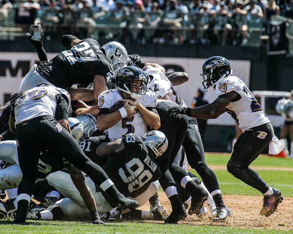 Sep 20 2015 - Oakland U.S. CA - Baltimore QB # 5 Joe Flacco get sack for a lost during NFL Football game between Baltimore Ravens and the Oakland Raiders 35-37 lost at O.co Coliseum Stadium Oakland Calif. Thurman James / CSM
