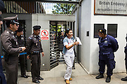 27 AUGUST 2013 - BANGKOK, THAILAND: A protester leaves the British embassy in Bangkok after meeting with a representative of the embassy. About 25 people, including at least two British citizens, picketed the embassy Tuesday morning. They were protesting against former British Prime Minister Tony Blair, who is expected to speak to a political reform commission established by Thai Prime Minister Yingluck Shinawatra. The protest leaders were invited in to the Embassy grounds to speak to representative of the British government. The protest disbanded afterwards. No one was arrested during the protest, which lasted a little over an hour.       PHOTO BY JACK KURTZ