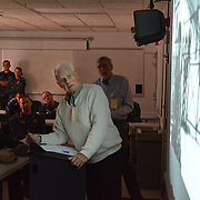 BATH, Maine -- 9/19/14 -- WWII Veteran and former POW, Stewart Day of Bath, Maine looks a the screen while speaking to members of the Zumwalt Precommissioning Unit  on POW/MIA Day, Sept 19.  Day, 91, flew 19 missions as a Tail Gunner in a B-17 over Europe before being shot down and captured. He spent the last days of WWII in a Prisoner of War camp, known as Stalag 17B. He presented his memories to the U.S. Navy unit based in his home town of Bath. U.S. Navy Photo by Chief Mass Communication Specialist Roger S. Duncan (RELEASED)